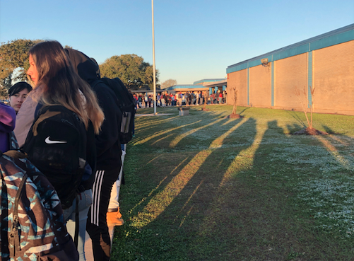 Nearly 20 minutes after classes started on Friday, Feb. 7, a long line of students are waiting to get into Beaumont ISD's West Brook High School, where it's the first day of a pilot program to utilize metal detectors to scan students entering the campus.