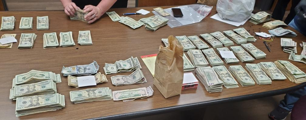 Cash and drugs found.