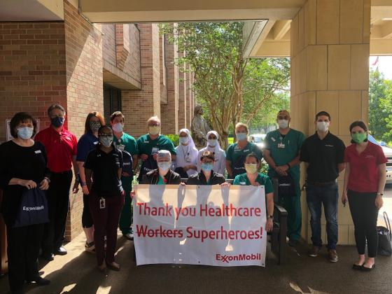 ExxonMobil representatives flank CHRISTUS employees